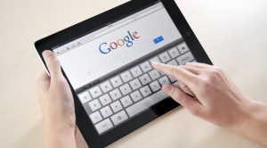 Image of tablet and someone using Google search, from Foss Marketing Group, Roseville CA